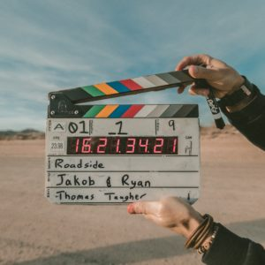 clapperboard on set, movie production, screenwriting writing online course for teens